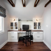 Built-in white office desk with tongue and groove wall covering